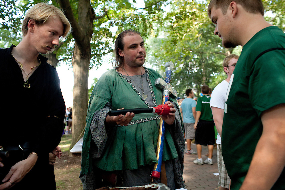 Choya Mansfield and Patrick Young explain the Medieval Society at the Campus Involvement Fair in Athens, Ohio on Sunday, August 25, 2013. Photo by Chris Franz