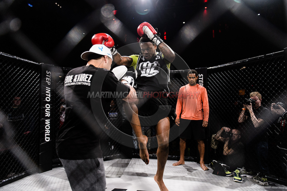 """LONDON, ENGLAND, MARCH 5, 2014: Eddie Alvarez holds pads for Michael Johnson during the media open work-out sessions for """"UFC Fight Night: Gustafsson vs. Manuwa"""" inside One Embankment London, England (Martin McNeil for ESPN)"""