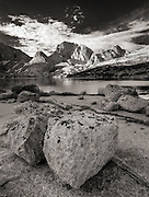 Glacial boulders along the shore of Deep Lake with Temple Peak rising in the background, Wind River Range, Wyoming