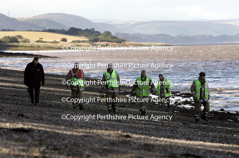 Police and Firefighters searching the shorleine near Newburgh in Fife looking for 16 year old Michael Udall who slipped into the Firth of Tay from a pier last night whilst fishing with a friend.<br />Picture by Graeme Hart.<br />Copyright Perthshire Picture Agency<br />Tel: 01738 623350  Mobile: 07990 594431