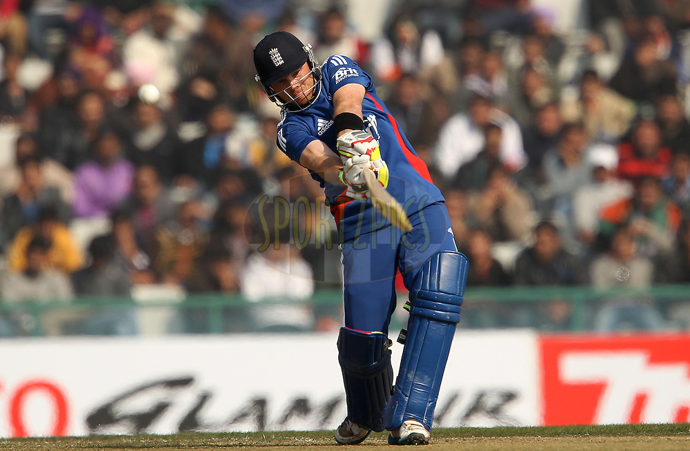 Ian Bell of England hits out and is caught by Bhuvneshwar Kumar of India during the 4th Airtel ODI Match between India and England held at the PCA Stadium, Mohal, India on the 23rd January 2013..Photo by Ron Gaunt/BCCI/SPORTZPICS ..Use of this image is subject to the terms and conditions as outlined by the BCCI. These terms can be found by following this link:..http://www.sportzpics.co.za/image/I0000SoRagM2cIEc