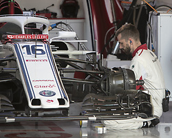 October 21, 2018 - Austin, USA - Members of the Alfa Romeo Sauber team prepare Alfa Romeo Sauber driver Charles Leclerc's car before the start of the Formula 1 U.S. Grand Prix at the Circuit of the Americas in Austin, Texas on Sunday, Oct. 21, 2018. (Credit Image: © Scott Coleman/ZUMA Wire)