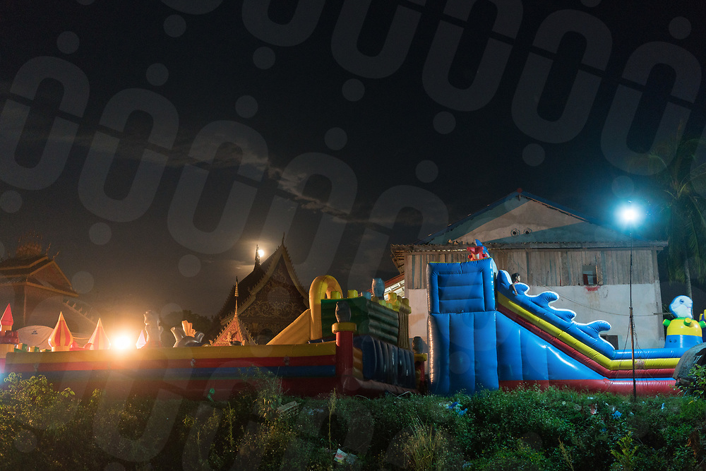May 10, 2017 - Muang Nan (Laos). A Bouncing castle is installed close to the village's pagoda for the festival. © Thomas Cristofoletti / Ruom