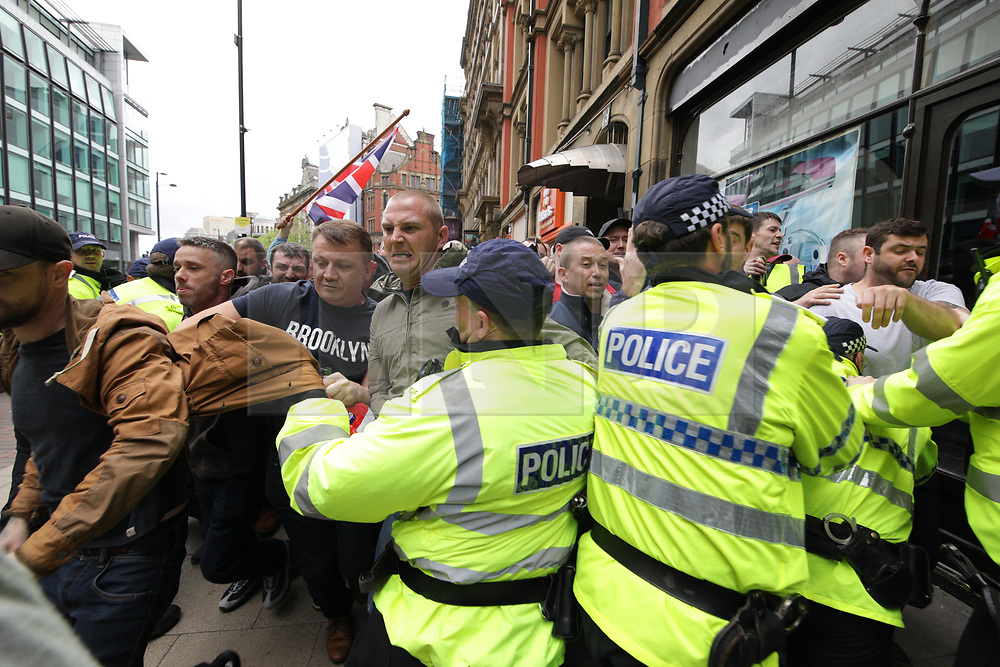"""© Licensed to London News Pictures . 11/06/2017 . Manchester , UK .  Demonstration against Islamic hate , organised by former EDL leader Tommy Robinson's """" UK Against Hate """" and opposed by a counter demonstration of anti-fascist groups . UK Against Hate say their silent march from Piccadilly Train Station to a rally in Piccadilly Gardens in central Manchester is in response to a terrorist attack at an Ariana Grande concert in Manchester , and is on the anniversary of the gun massacre at the Pulse nightclub in Orlando . Photo credit: Joel Goodman/LNP"""