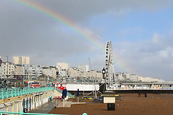 © Licensed to London News Pictures. 14/09/2015. Brighton, UK. A rainbow appears over Brighton in between showers. Brighton and the South Coast is being battered by strong winds and powerful waves. Today September 14th 2015. Photo credit : Hugo Michiels/LNP