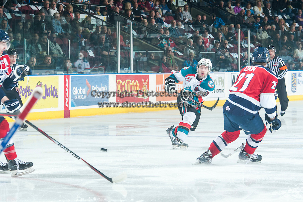 KELOWNA, CANADA - MARCH 27: Colten Martin #8 of Kelowna Rockets take a shot against the Tri-City Americans on March 27, 2015 at Prospera Place in Kelowna, British Columbia, Canada.  (Photo by Marissa Baecker/Shoot the Breeze)  *** Local Caption *** Colten Martin