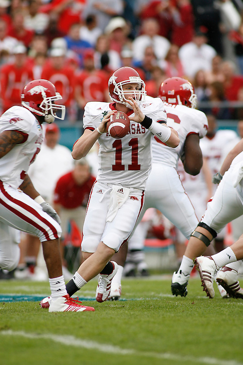 University of Arkansas quarterback Casey Dick rolls out to pass during the Wisconsin Badgers 17-14 victory over the Arkansas Razorbacks on January 1, 2007 at the Florida Citrus Bowl Stadium in Orlando, Florida.