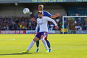 AFC Wimbledon defender Nesta Guinness-Walker (18) battles for possession with Shrewsbury Town attacker Callum Lang (9) during the EFL Sky Bet League 1 match between AFC Wimbledon and Shrewsbury Town at the Cherry Red Records Stadium, Kingston, England on 14 September 2019.