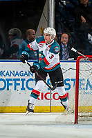 KELOWNA, CANADA - JANUARY 9: Dalton Gally #3 of the Kelowna Rockets passes the puck from behind the net against the Everett Silvertips  on January 9, 2019 at Prospera Place in Kelowna, British Columbia, Canada.  (Photo by Marissa Baecker/Shoot the Breeze)