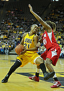 January 08 2010: Iowa guard Kachine Alexander (21) tries to get around Ohio St. guard Brittany Johnson (40) during the first half of an NCAA womens college basketball game at Carver-Hawkeye Arena in Iowa City, Iowa on January 08, 2010. Iowa defeated Ohio State 89-76.