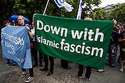 Frankfurt am Main | 04 Aug 2014<br /> <br /> Am Montag (04.08.2014) demonstrierten in Frankfurt am Main etwa 400 Menschen aus verschiedenen linken und linksradikalen Gruppen, aus der j&uuml;dischen Gemeinde und der Frankfurter Stadtgesellschaft gegen Antisemitismus und Judenhass. In den vergangenen Wochen war es in der Bankenstadt immer wieder zu antisemitischen Vorf&auml;llen wie Schmierereien an einer Synagoge, Hass-Kundgebungen oder einer eingeworfenen Scheibe bei einer j&uuml;dischen Familie und Beschimpfungen als &quot;Judenschweine&quot; gekommen.<br /> Hier: Transparent mit der Aufschrift &quot;Down With Islamic Fascism&quot;<br /> <br /> &copy;peter-juelich.com<br /> <br /> [No Model Release | No Property Release]
