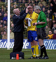 Photo. Glyn Thomas.<br /> Mansfield Town v Hull City.<br /> Nationwide League Division 3.<br /> Field Mill, Mansfield. 06/03/2004.<br /> Mansfield's Tony Vaughan (C) receives treatment for a cut eye.