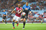 Bournemouth defender Tommy Elphick (5) battles with Aston Villa forward Jordan Ayew (19) during the Barclays Premier League match between Aston Villa and Bournemouth at Villa Park, Birmingham, England on 9 April 2016. Photo by Jon Hobley.