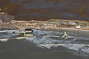 Aerial showing beach erosion leaving structures standing in the Atlantic Ocean on Folly Beach, South Carolina.