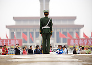 """A Chinese soldier stands guard on Tiananmen Square in central Beijing  the last day of the National Day week-long holiday. Introduced seven years ago, """"Golden Weeks"""", including the National Day holiday, the May Day holiday and the traditional Spring Festival, were created to stimulate spending and tourism across the nation. The holidays are one of the world's biggest movements of people, as millions travel back to their home towns, domestic tourist spots, or increasingly, abroad. ...."""