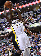 March 13, 2012; Indianapolis, IN, USA; Indiana Pacers shooting guard Paul George (24) shoots the ball against the Portland Trail Blazers at Bankers Life Fieldhouse. Indiana defeated Portland 92-75. Mandatory credit: Michael Hickey-US PRESSWIRE