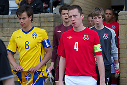 FLINT, WALES - Thursday, May 12, 2011: Wales' captain Gethin Jones walks out with Sweden's captain Melker Hallberg during the Men's Under-17's International Friendly match at Cae-y-Castell. (Photo by David Rawcliffe/Propaganda)