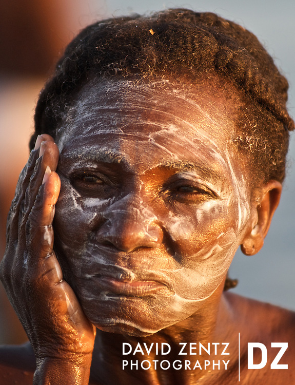 A pilgrim cleanses herself with ash soap in the sea during a sunrise voodou ritual at Bord de Mer de Limonade, on the north coast of Haiti on July 25, 2008. After renewing their faith in the mud pit at Plaine du Nord on the days prior, pilgrims migrate to the nearby water, their faith renewed.