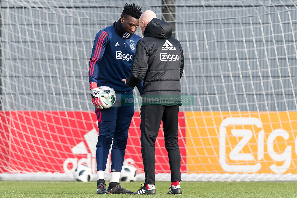 (L-R) goalkeeper Andre Onana of Ajax, coach Erik ten Hag of Ajax during the trainings session of Ajax Amsterdam at the Toekomst on January 30, 2018 in Amsterdam, The Netherlands