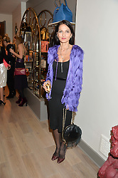 YASMIN MILLS at a party hosted by Melissa Del Bono to celebrate the launch of her Meli Melo flagship store at 324 Portobello Road, London W10 on 28th November 2013.