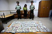 SHENZHEN, CHINA - JUNE 07: (CHINA OUT) <br /> <br /> A woman is arrested as she tied 220,000 US dollars on legs on June 7, 2016 in Shenzhen, Guangdong Province of China. Armed police of Guangdong Frontier Defense Bureau arrested a woman with 220,000 US dollars tied on her legs and a woman hiding over 3,000 memory cards in her private part when they were checked at the entry to Shenzhen on Tuesday. <br /> ©Exclusivepix Media