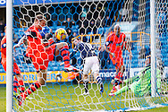 David Wheater of Bolton Wanderers clears a Millwall shot off the line during the Sky Bet Championship match at The Den, London<br /> Picture by David Horn/Focus Images Ltd +44 7545 970036<br /> 15/02/2014