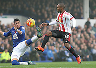 Jermain Defoe of Sunderland skips around Ramiro Funes Mori before going on to score the first goal against Everton during the Barclays Premier League match at Goodison Park, Liverpool.<br /> Picture by Michael Sedgwick/Focus Images Ltd +44 7900 363072<br /> 01/11/2015