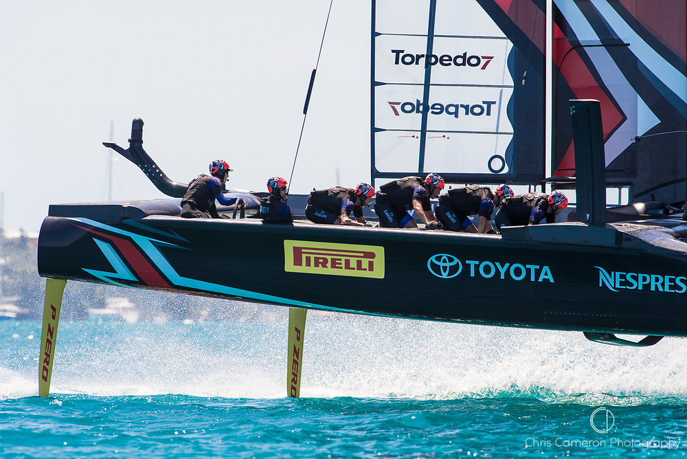 The Great Sound, Bermuda, 18th June. Emirates Team New Zealand rounds the top mark ahead of Oracle Team USA in race four on day two of the America's Cup.