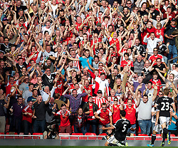 21.09.2013, Anfield, Liverpool, ENG, Premier League, FC Liverpool vs FC Southhampton, 5. Runde, im Bild Southampton's Dejan Lovren celebrates the first goal during the English Premier League 5th round match between Liverpool FC and Southampton FC at Anfield, Liverpool, Great Britain on 2013/09/21. EXPA Pictures &copy; 2013, PhotoCredit: EXPA/ Propagandaphoto/ Alan Seymour<br /> <br /> ***** ATTENTION - OUT OF ENG, GBR, UK *****
