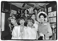 1990's:  A group portrait of Joan Crawford impersonators in drag in New York City.