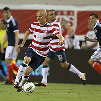 United States Midfielder Michael Bradley (4) during an international friendly soccer match between Scotland and the United States at EverBank Field on Saturday, May 26, 2012 in Jacksonville, Florida.  The United States won the match 5-1 in front of 44,000 fans. (AP Photo/Alex Menendez)