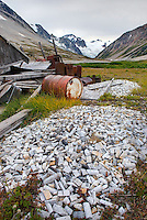 Discarded mining equipment with piles of core samples in the foreground, Athelney Pass, Coast Range British Columbia Canada
