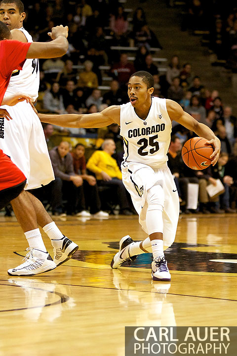December 29, 2012: Colorado Buffaloes sophomore guard SPENCER DINWIDDIE (25) brings the ball around a screen set by teammate freshman forward JOSH SCOTT (40) in the first half of the NCAA Basketball game between the University of Hartford Hawks and the Colorado Buffaloes at the Coors Event Center in Boulder Colorado