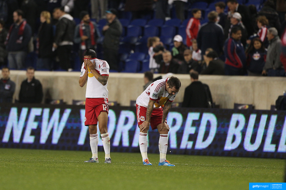 Tim Cahill, (left) and Jonny Steele, distraught at their sides loss after the final whistle during the New York Red Bulls V Houston Dynamo, Major League Soccer second leg of the Eastern Conference Semifinals match at Red Bull Arena, Harrison, New Jersey. USA. 6th November 2013. Photo Tim Clayton
