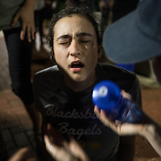 CHARLOTTESVILLE,VA-AUG11:A counter protestor is overcome with tear gas after hundreds of white nationalists and white supremacists carrying torches marched in a parade through the University of Virginia campus. Beginning a little after 9:30 p.m., the march lasted 15 to 20 minutes before ending in skirmishing when the marchers were met by a small group of counterprotesters at the base of a statue of Thomas Jefferson, the university's founder. (Photo by Evelyn Hockstein/For The Washington Post)