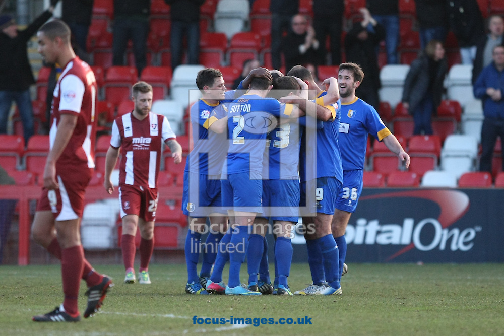 Picture by Mark Hawkins/Focus Images Ltd 07949 023795<br /> 29/12/2013<br /> Mansfield Town players celebrate their first goal against Cheltenham Town during the Sky Bet League 2 match at the Abbey Business Stadium, Cheltenham.