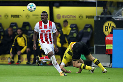 DORTMUND, Sept. 18, 2017  Papastathopoulos Sokratis (R) of Borussia Dortmund and Jon Cordoba of 1.FC Cologne vie for the ball during the Bundesliga soccer match between Borussia Dortmund and 1.FC Cologne at the Signal Iduna Park in Dortmund, Germany on Sept. 17, 2017. Borussia Dortmund won 5-0. (Credit Image: © Joachim Bywaletz/Xinhua via ZUMA Wire)