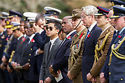 Dignitaries, including the Australian Ambassador to Japan, Richard Court (third from right) and  military personnel lined up during the Remembrance Sunday ceremony at the Hodogaya, Commonwealth War Graves Cemetery in Hodogaya, Yokohama, Kanagawa, Japan. Sunday November 11th 2018. The Hodagaya Cemetery holds the remains of more than 1500 servicemen and women, from the Commonwealth but also from Holland and the United States, who died as prisoners of war or during the Allied occupation of Japan. Each year officials from the British and Commonwealth embassies, the British Legion and the British Chamber of Commerce honour the dead at a ceremony in this beautiful cemetery. The year 2018 marks the centenary of the end of the First World War in 1918.