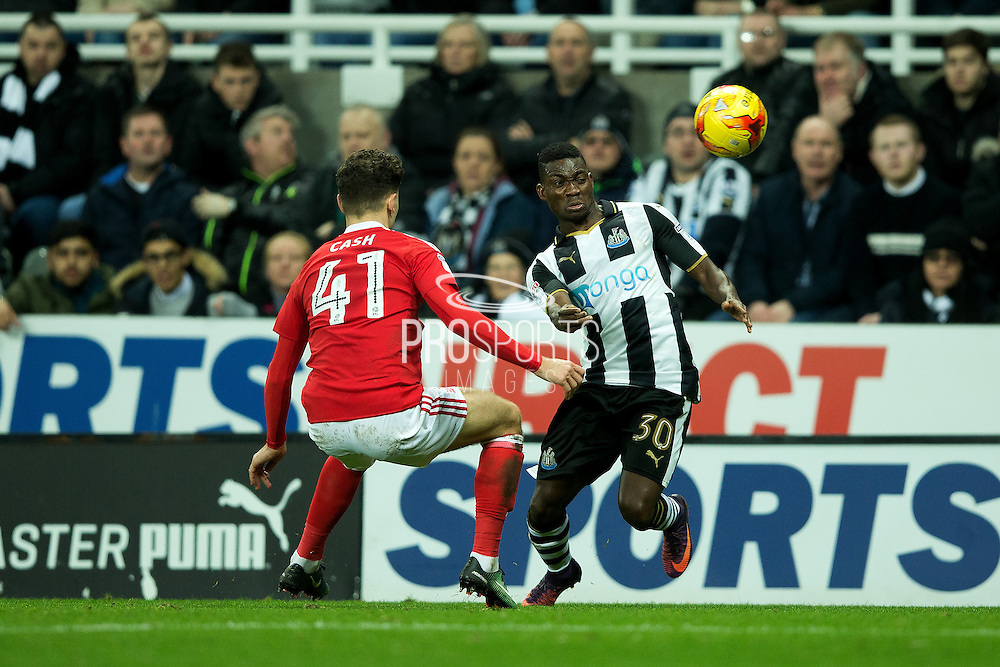 Newcastle United midfielder Christian Atsu (#30) flicks the ball away from Nottingham Forest midfielder Matty Cash (#41) during the EFL Sky Bet Championship match between Newcastle United and Nottingham Forest at St. James's Park, Newcastle, England on 30 December 2016. Photo by Craig Doyle.