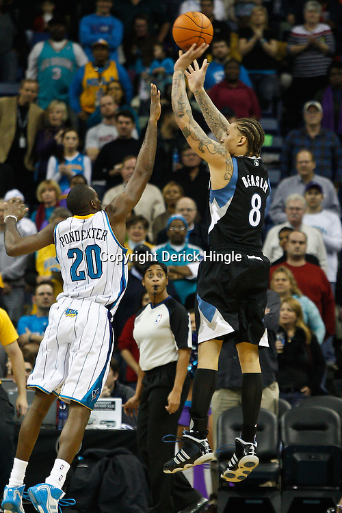 February 7, 2011; New Orleans, LA, USA; Minnesota Timberwolves power forward Michael Beasley (8) shoots over New Orleans Hornets small forward Quincy Pondexter (20) during the first quarter at the New Orleans Arena.   Mandatory Credit: Derick E. Hingle