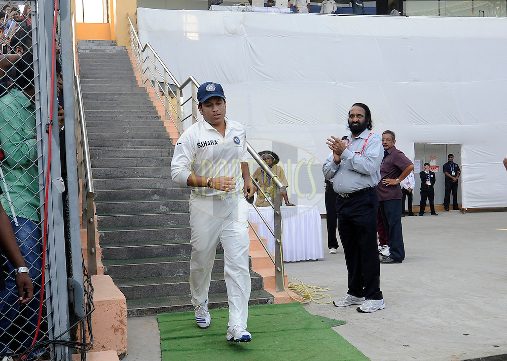 Sachin Tendulkar of India walks down the dressing room to take field before the start of play on day one of the second Star Sports test match between India and The West Indies held at The Wankhede Stadium in Mumbai, India on the 14th November 2013<br /> <br /> This test match is the 200th test match for Sachin Tendulkar and his last for India.  After a career spanning more than 24yrs Sachin is retiring from cricket and this test match is his last appearance on the field of play.<br /> <br /> Photo by: Pal PIllai - BCCI - SPORTZPICS<br /> <br /> Use of this image is subject to the terms and conditions as outlined by the BCCI. These terms can be found by following this link:<br /> <br /> http://sportzpics.photoshelter.com/gallery/BCCI-Image-Terms/G0000ahUVIIEBQ84/C0000whs75.ajndY