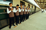 "Stewards of the Eastern & Oriental Express welcoming passengers with a traditional ""Wai""."