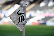 General view of the Swansea City logo on the cornewr flag in side the stadium ahead of the EFL Sky Bet Championship match between Swansea City and Middlesbrough at the Liberty Stadium, Swansea, Wales on 14 December 2019.