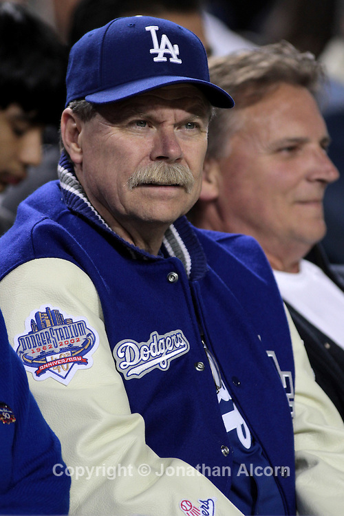A Los Angeles Dodger fan watches the action during the Dodgers  6-1 victory over the Atlanta Braves at Dodger Stadium in Los Angeles on April 20, 2011. Major League Baseball Commissioner Bud Selig announced Wednesday the league office is assuming control of the Los Angeles Dodgers, in the wake of a report team owner Frank McCourt is struggling to pay bills.