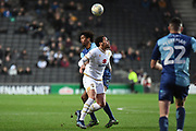 Milton Keynes Dons (on loan from Norwich City) Louis Thompson (19) battles for possession  with Wycombe Wanderers defender Sido Jambati (2) during the EFL Sky Bet League 1 match between Milton Keynes Dons and Wycombe Wanderers at stadium:mk, Milton Keynes, England on 1 February 2020.