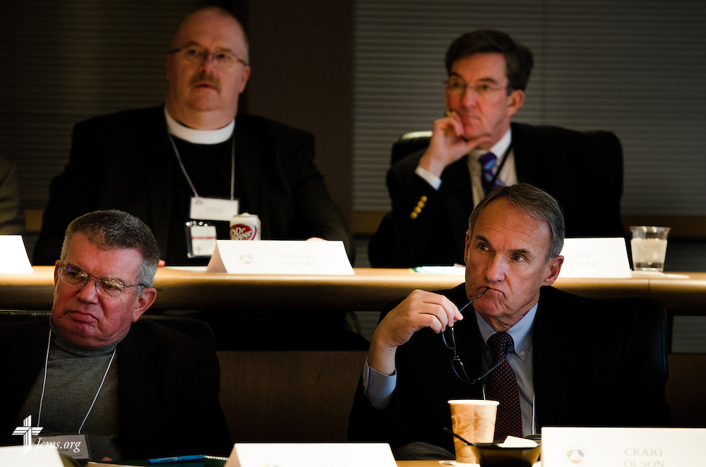 "(L-R, clockwise) Dr. Dale Meyer, president of Concordia Seminary in St. Louis, the Rev. Timothy Scharr, president of the LCMS Southern Illinois District, the Rev. Dr. Scott Murray, fourth vice-president of the LCMS, and Craig Olson, member of the Board of Regents at Concordia University Irvine, Calif., listen as the Rev. Dr. William Weinrich (left), professor at Concordia Theological Seminary in Fort Wayne, Ind., presents during a ""Think Tank"" of representatives from Concordia University Schools, boards, and others at the International Center of The Lutheran Church--Missouri Synod on Monday, March 31, 2014, in Kirkwood, Mo. LCMS Communications/Erik M. Lunsford"