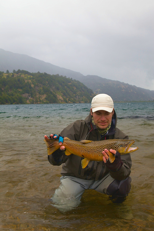 When the gales forced me to take photos  instead of catching fish, I suggested that my guide give it a try. Wading about 20 feet from the beach, his third cast tempted this trophy brown. Rio Paloma Lodge.
