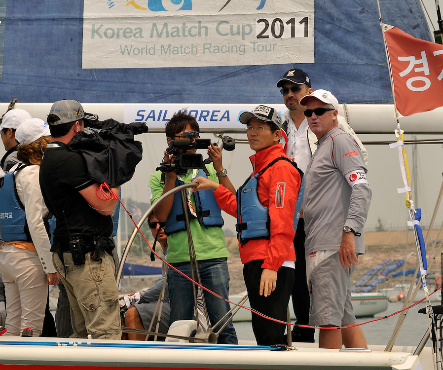 WMRT Executive Chairman, Patrick Lim, joins Kim Moon Soo, Governor of Gyeonggi Province alongside Peter Gilmour, Yanmar Racing at the helm for the Pro-Am race. Photo:Chris Davies/WMRT