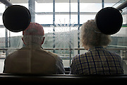 Infirm and elderly transit passengers await transport by buggy through Heathrow airport's terminal 5