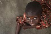 Portrait of young Ghanaian boy in small town near Swedru.